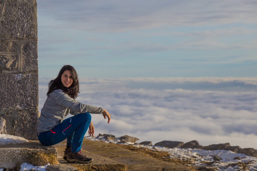 Trekking of the Mount Matajur above a sea of clouds